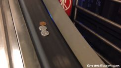 Coins On Escalator Rail thumbnail